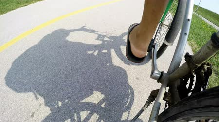cyclists : Cyclist and his shadow on a cycling path, 4K video