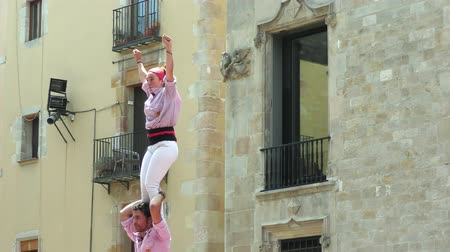 festa : BARCELONA, SPAIN - JUNE 26, 2016: Castellers group of people that build human castles on June 26, 2016 in Barcelona.  Castles is a Human Tower traditional festivities in Catalonia Spain.