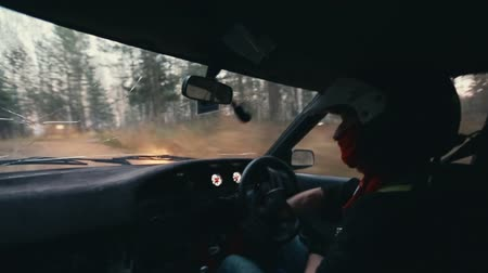 ралли : Rally car driver during race