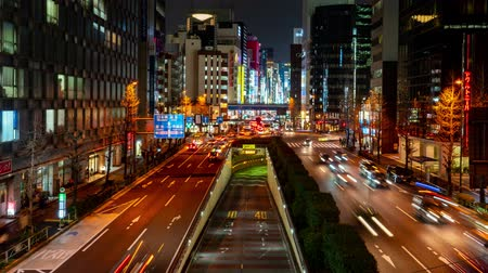 spousta : Shimbashi, Japan- February 6, 2019: 4K time lapse video of Tokyo road at Shimbashi and Ginza Tokyo main roads in the city traffic During rush time lots of cars on the road, business district