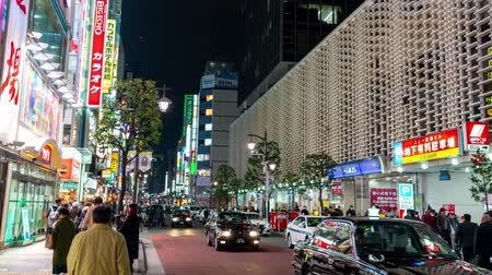 vdo : Shimbashi, Japan- February 6, 2019: 4K time lapse video of People walking in the street bars early evening to reveal the main intersection and nightlife