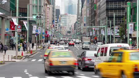 ginza : Ginza, Tokyo, Japan- February 6, 2019: 4K time lapse video of Pedestrians tourists and shoppers walking on Ginza street at Ginza district, famous for its shopping.