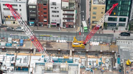 kanto : Ginza, Tokyo, Japan- February 6, 2019: 4K Aerial time lapse video of Birdseye view Construction Site in ginza Stock Footage