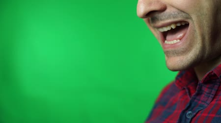 Talking man mouth closeup. green screen background