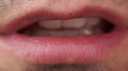 Extreme close up video mans lips speaks