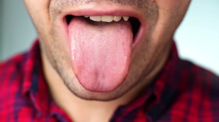 man shows tongue red , white screen background