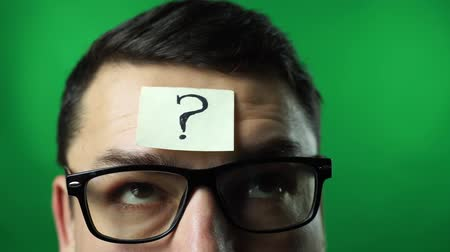 thinking man with question mark on gray wall background green screen background