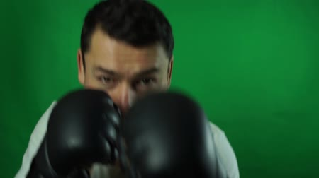 portrait of a handsome man boxing isolated green screen background