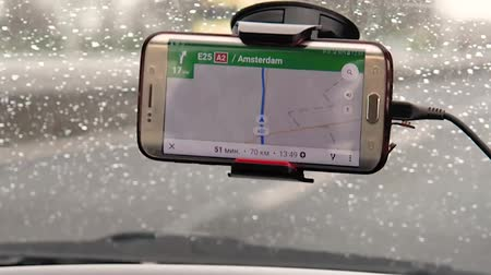 gps phone navigator in front of the car