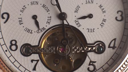 The mechanism of a wristwatch antique style. The camera moves around. Closeup. Clock pendulums, date, day, hour, minutes Vídeos