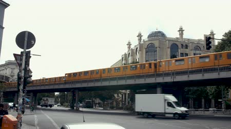 arriving : Berlin, Germany - July 13, 2018: Two Metro Trains (U-Bahn) at Schlesisches Tor Station and busy Berlin Street Stock Footage