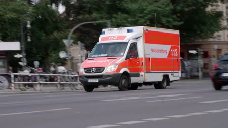 rohanó : Berlin, Germany - July 13, 2018: Ambulance (Notarzt) driving by with flashing blue lights on (Blaulicht)