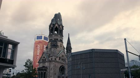 breitscheidplatz : Berlin, Germany - July 13, 2018: Tilt down Kaiser Wilhelm Memorial Church (Gedächtniskirche) in 4K