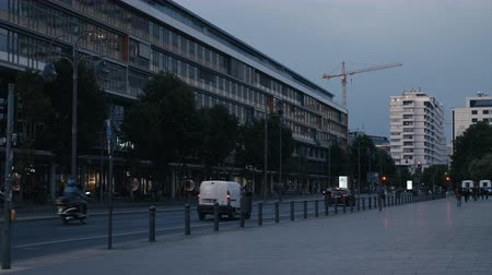 breitscheidplatz : Cars driving on Budapester Strasse in Berlin in the Evening with Headlights turned on