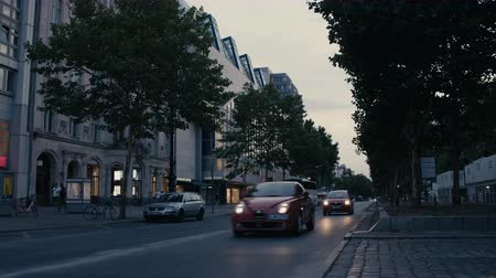 Cars driving along Kudamm (Kurfuerstendamm) at the Evening in Charlottenburg in 4K
