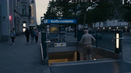 meio : Berlin, Germany - July 13, 2018: Someone walking down Metro (U-Bahn) Entrance Kurfuerstendamm in Charlottenburg