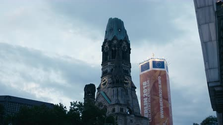 breitscheidplatz : Berlin, Germany - July 13, 2018: Tilt down from Kaiser Wilhelm Memorial Church (Gedaechtniskirche) to Kudamm and Breitscheidplatz in Berlin - 4K