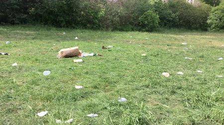 People scattered trash and garbage everywhere in the public park Hasenheide  Bunnyheap after street festival Karneval der Kulturen.