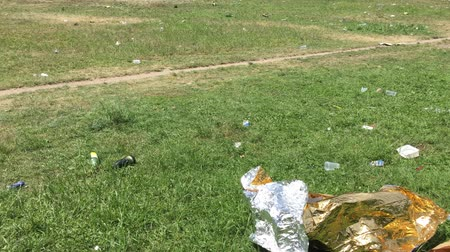 Big piece of tin foil and trash scattered around public park after festival in Berlin
