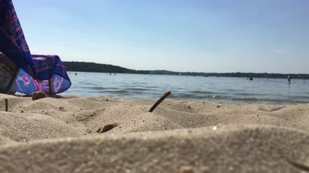 CloseUp of Beach and Sand at Water and Lake at Hot Summer Day at Wannsee in Berlin 動画素材