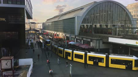 BERLIN - SEPTEMBER 21, 2017: Timelapse of Tram and suburban train arriving and departing at busy Alexanderplatz - Top View