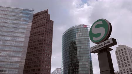 meio : BERLIN - SEPTEMBER 17, 2017: S-Bahn  Metro Sign and Entrance at Potsdamer Platz in Berlin - Dolly  Gimbal Shot Stock Footage