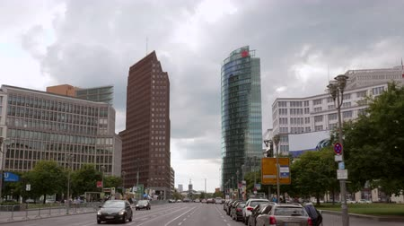 BERLIN - SEPTEMBER 17, 2017: High-Rise Buildings at Potsdamer Platz. Dolly  Gimbal Wide Shot in 25p 4K Stock mozgókép