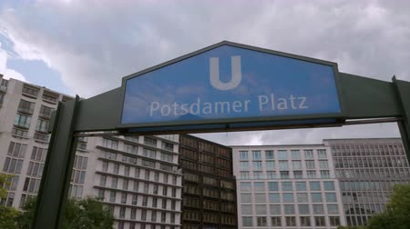 Camera moving around Subway  Metro  Subway Entrance Sign at Potsdamer Platz, Berlin - Gimbal  Dolly Shot - 4K