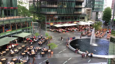 Berlin, Germany - May 25,2018: Pan over people enjoying restaurants and services at Potsdamer Platz Sony Center