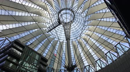 Berlin, Germany - May 25,2018: Tilt from roof to people enjoying dining at Potsdamer Platz Sony Center
