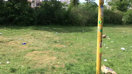 aftermath : Berlin, Germany - May 23 2018: Trash scattered in a Public Park after Festival Carnival of Cultures
