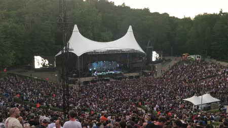 BERLIN - JULY 5, 2018: Open air rock concert in the sold-out forest stage - wide shot