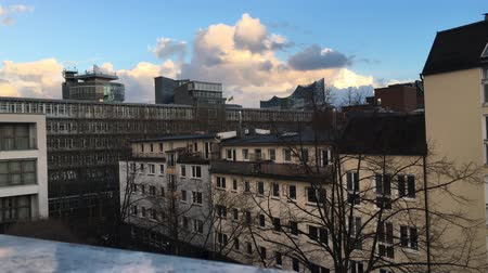 HAMBURG - MARCH 18, 2019: View over roof tops on Elbphilharmonie with moving clouds and sunshine 動画素材