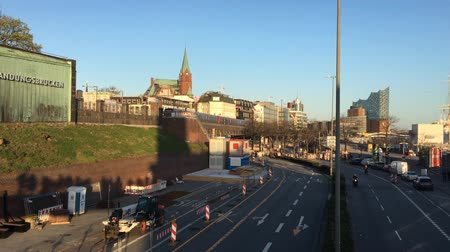 tersane : HAMBURG - MARCH 31, 2019: Metro and street at Landungsbruecken in Sankt Pauli with Elbphilharmonie in the background at sun set