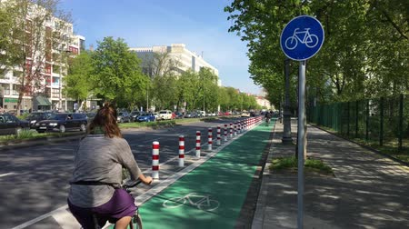 BERLIN - APRIL 20, 2019: New Protected Bike Lane in Berlin - Cyclists passing by