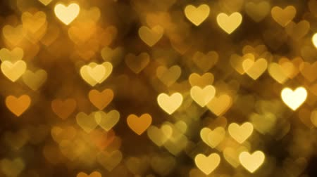 コントラスト : Abstract heart bokeh background yellow color 動画素材