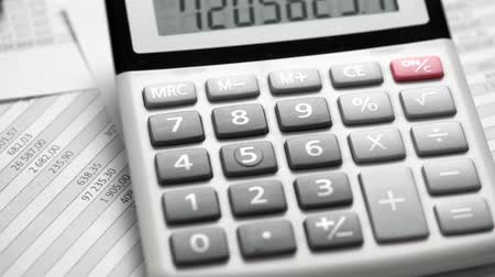 planilha : Calculator and reports closeup. Office supplies for working and calculating finance. Business financial accounting concept.