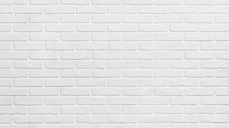 кирпичная кладка : white brick wall background zoom effect Стоковые видеозаписи
