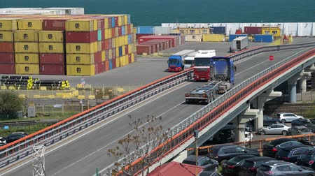 camionagem : Industrial port in Odessa city, Ukraine, May 4, 2019 - Trucks are going across the industrial seaport