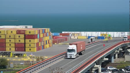 manifatura : Industrial port in Odessa city, Ukraine, May 4, 2019 - Trucks are going across the industrial seaport