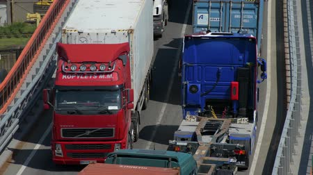 manifatura : Industrial port - Trucks are going across the industrial seaport