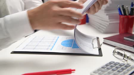 magnifier : Businessman working and calculating, reads and writes reports. Office employee, table closeup. Business financial accounting concept.