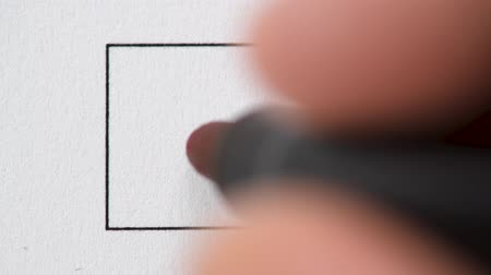 accepting : Macro of hand drawing red check mark on paper with marker. Stock Footage