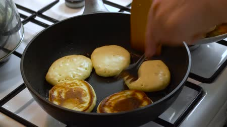 Cooking pancakes in home kitchen, dough, hot pan and stove Стоковые видеозаписи