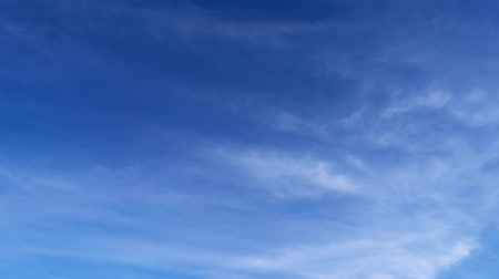 Timelapse of Bright beautiful blue sky with soft clouds for background or texture