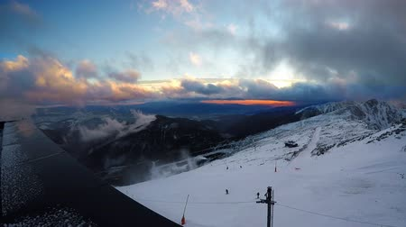 Fast running clouds over Low Tatras with magic sunset. Chopok mountain 2024 meters