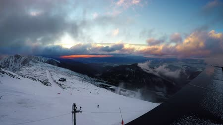 Fast running clouds over Low Tatras with magic sunset. Chopok mountain 2024 mete
