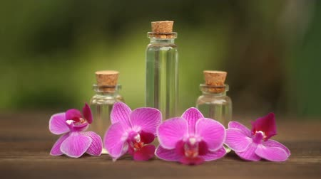 orchid infusion : Essence of orchid flowers on a table in a beautiful glass jar