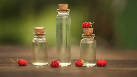 strawberry oil : Essence of Wild strawberry on table in beautiful glass jar