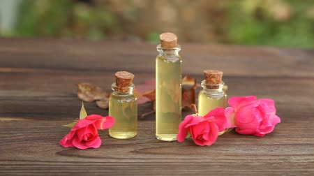 rose extract : Essence of flowers on a table in beautiful Bottle